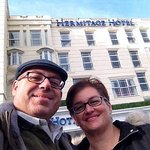Hotel front and two happy customers