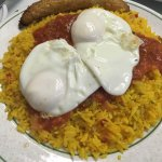 Arroz a la cubana: spicy tomato sauce on rice with 2 fried eggs and fried banana