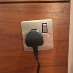 The installation of this socket made me chuckle for a 4-star hotel.