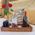 Complimentary wine, grapes, roses and chocolate greet guests as they arrive