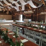 These beautiful rustic farm tables are included