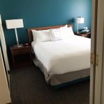 Our room, smaller vanity to left, private bathroom. Very comfortable all around, doors for priva