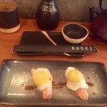 Quail eggs over salmon sushi