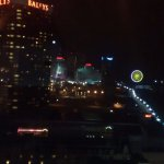 boardwalk and ferris wheel at night