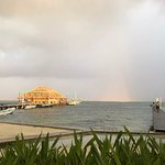 View of rainbow over the reef from golf cart parked in front of 2A