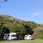 Sunny or shady sites for campervans beside the Okuti River.