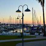 Outdoor dining view of the marina at sunset.