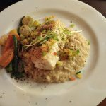 Fresh sesame encrusted halibut with grilled pineapple cilantro salsa and risotto.  YUMMY.