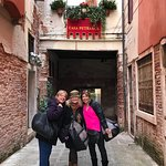 3 of the 4 of us on our birthday trip to Venice. Just behind us is a canal!