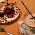 spectacular chocolate cake dessert with a coffee drink