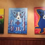 Some of the paintings at Blue Dog Cafe