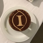 Anniversary gift of champagne and cake. The one with the logo is Tiramisu we ordered for dessert