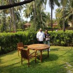 Private lawn with table and chairs in the villa