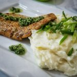 Grilled Fish with Cheddar Chive Mashed Potatoes. Served with our homemade house Garlic Chimichur