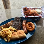 Ribs combo plate with beef brisket, smoked sausage, and a half order of smoked chicken wings.