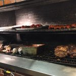meats roasting behind the counter