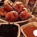 Zeppole with dark chocolate and warm honey