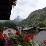 View of the Matterhorn from a flower filled balcony