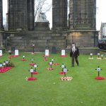Remembrance Day poppies at base of monument