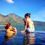 soak in hot spring water and enjoy the view of lake batur with your fav drink