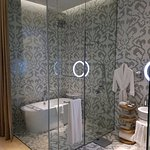 Spacious bathroom, glass shower