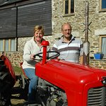Brenda and Ian with Fergi outside the Corn Barn (left) and the Threshing Barn (right).