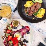 Eggs Benny Crispy Bacon, house made hollandaise, side of avocado with Vanilla Panna cotta & gran