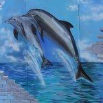 Beach area and dolphin mural