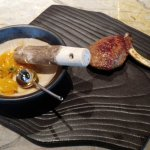 Curry. Persimmon, micro greens, spices and curry encapsulated in Lamb chop.