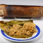 Rice mixed with tribal masala stuffed inside a green bamboo and spit roasted to cook the rice