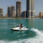 """enjoying the jet-ski, The """"Pearl"""" construction work in the background"""
