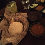 Spicy Chips and Salsa along with a Bean Dip - very good