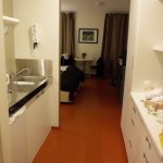 Kitchenette on left, cupboards on right when you enter the room