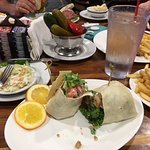 I had chicken tender wrap.....they serve fresh dill pickles,green tomatoes & peppers..DELICIOUS