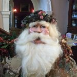 This beautfiful Santa is 5 feet tall and has a wax face.  His clothing is made from antique text