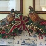 Pheasant help decorate the mantle in the billiard room.