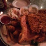 fish plate with sides of cole slaw and hush puppies.
