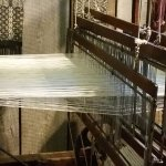 An actual loom, where a weaver makes articles for purchase