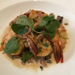 Grilled shrimp over mushroom infused faro.