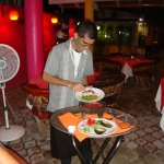 Oscar preparing salsa de molcajete and guac - YUM!!