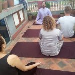 Guest enjoying Yoga in roof top terrace