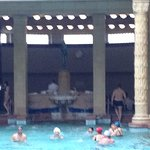 Swimming pool with fountain in the background & another thermal pool behind fountain