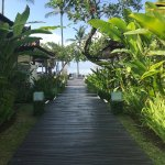 This is the walkway leading to the restaurant and pool area. It is waterside.