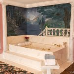 Moonlight's oversized jetted tub; candles in the room, and a fireplace.