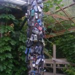 The pole outside, decorated with old mobile phones