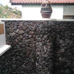 Shower with black stones