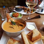 The seafood soup with bread and a yogurt dip