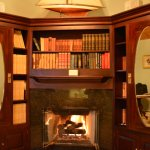 Gas fireplace burns warm in the den of Cliff Suite