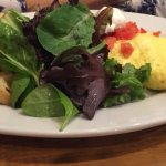 The Works Omelet with fresh greens and potatoes