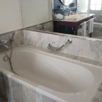 Amenities are available for bath tub use.
